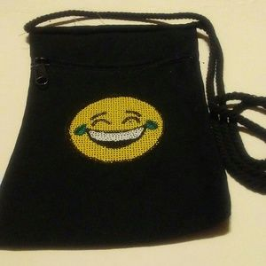 New black cross body purse.